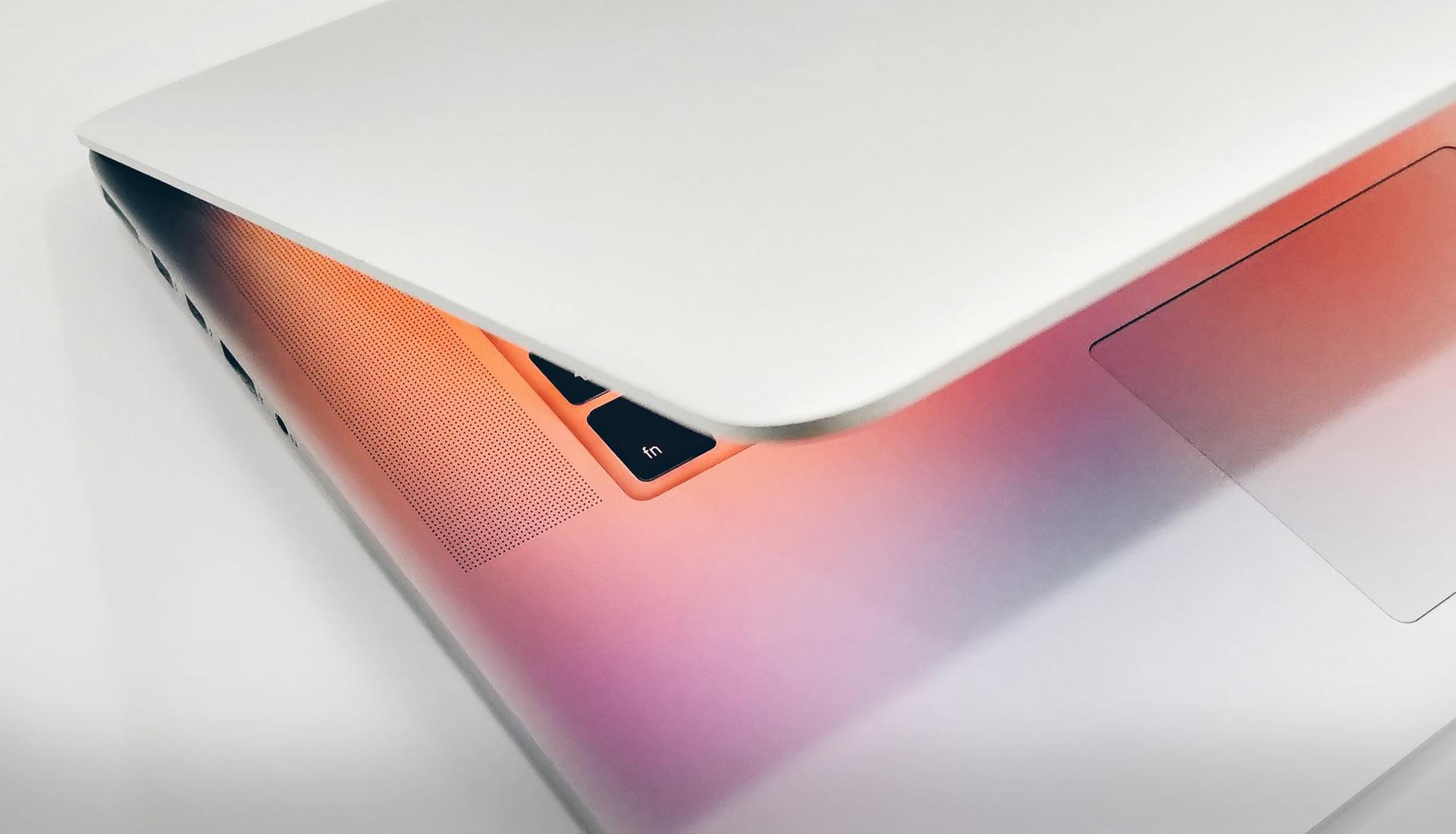 MacBook Pro half open with pinkish light